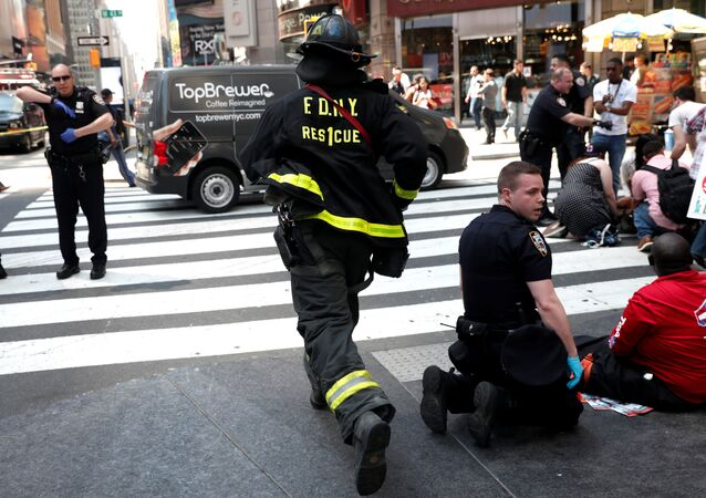 A New York City Fire Department (FDNY) emergency worker rushes to a scene in Times Square after a speeding vehicle struck pedestrians on the sidewalk in New York City, U.S., May 18, 2017.
