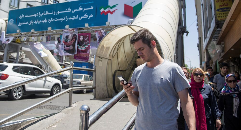 A man uses his smartphone to follow election news in Tehran, Iran May 17, 2017