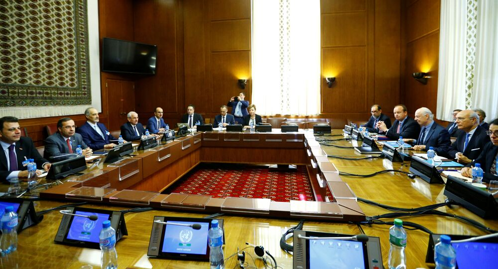 United Nations Special Envoy for Syria Staffan de Mistura and Syrian government negotiator Bashar Ja'afari attend a meeting during Intra Syria talks along with their delegations at the U.N. in Geneva, Switzerland, May 16, 2017