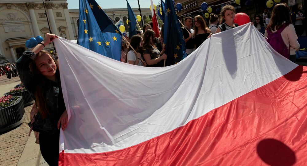 People hold European Union and Polish flags during the annual EU parade in Warsaw, Poland May 6, 2017