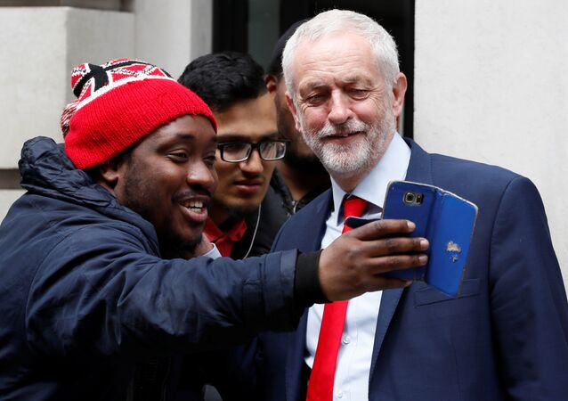 Jeremy Corbyn, the leader of Britain's opposition Labour Party, poses for a selfie as he leaves BBC radio studios in London, May 18, 2017.