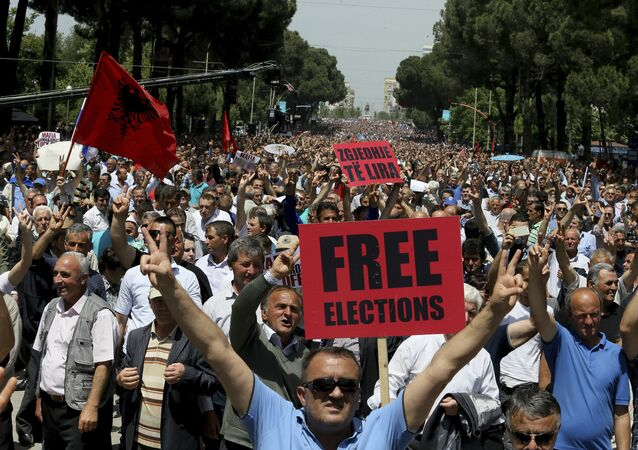 Supporters of Albania's main opposition take part in a protest demanding a caretaker cabinet to take the country to the June 18 parliamentary election, on Saturday, May 13, 2017