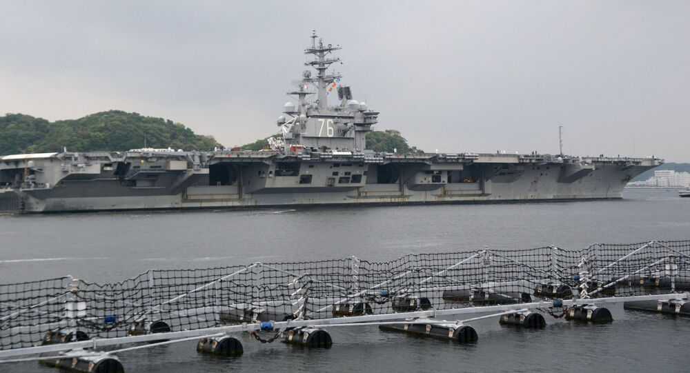 USS Ronald Reagan, a Nimitz-class nuclear-powered supercarrier, leaves from its home port to be deployed in waters near Japan, in Yokosuka, south of Tokyo, Japan, in this photo taken by Kyodo May 16, 2017