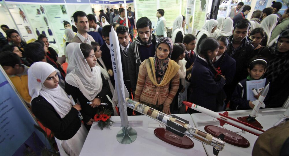 Indian students look at models of missiles in an exhibition by the Indian Defense Research and Development Organization (DRDO) at the 101st Indian Science Congress in Jammu, India, Friday, Feb. 7, 2014