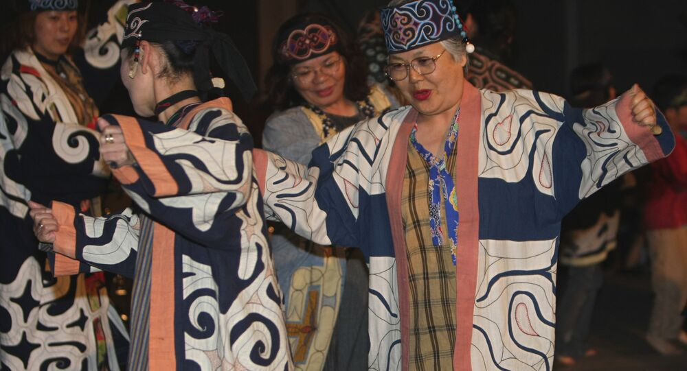 Ainu's audience enjoy in a concert of the Indigenous Peoples Summit in Sapporo, northern Japan, Friday, July 4, 2008.
