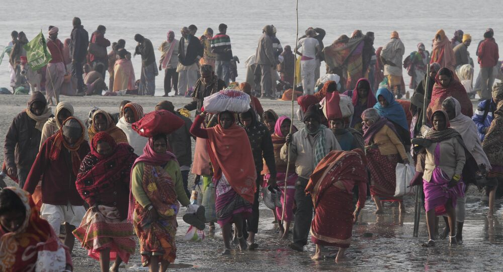 Pilgrims return after a holy dip in the confluence of the Bay of Bengal and Ganges River on Makar Sankranti festival in Gangasagar, India, Sunday, Jan. 15, 2017