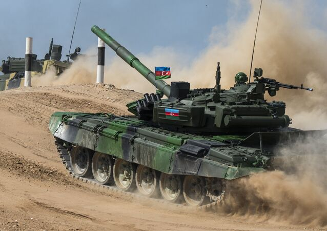 Azerbaijan's T-72B3 tank crew seen competing in the semifinals of the Tank Biathlon competitions at the Alabino range