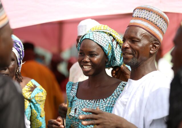 One of the newly released 82 Chibok school girls reunites with her family in Abuja, Nigeria May 20, 2017.