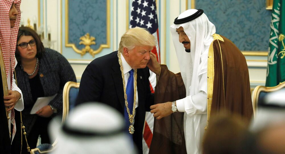 Saudi Arabia's King Salman bin Abdulaziz Al Saud (R) presents U.S. President Donald Trump (C) with the Collar of Abdulaziz Al Saud Medal at the Royal Court in Riyadh, Saudi Arabia May 20, 2017. Picture taken May 20, 2017