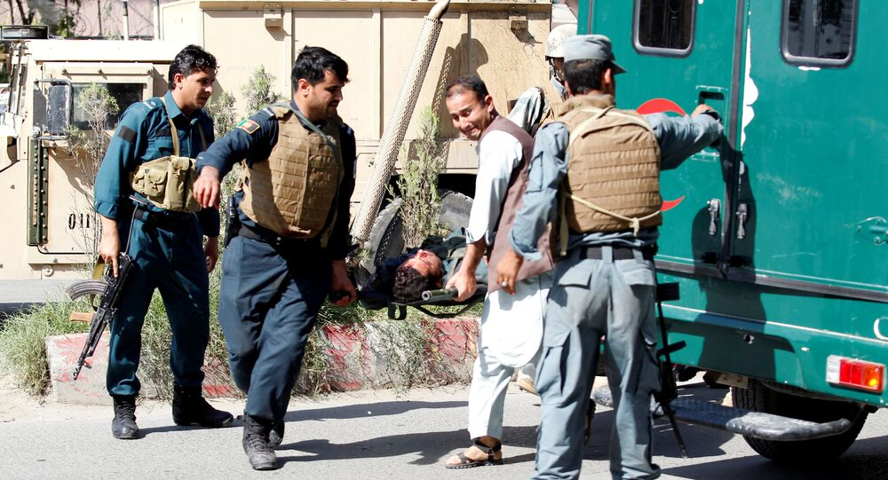 Afghan policemen transport a dead body of a police after gunmen attack in Jalalabad city eastern Afghanistan May 17, 2017