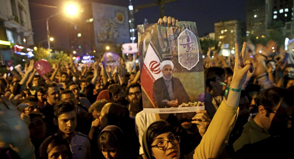 Supporters of Iranian President Hassan Rouhani celebrate after he won the presidential election in Tehran, Iran, Saturday, May 20, 2017