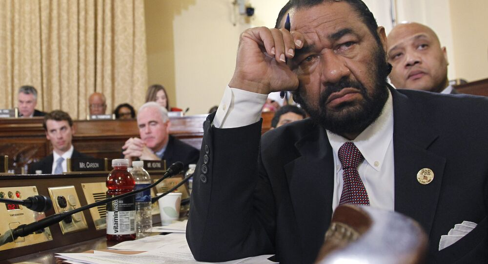 Rep. Al Green, D-Texas, listens intently to emotional testimony