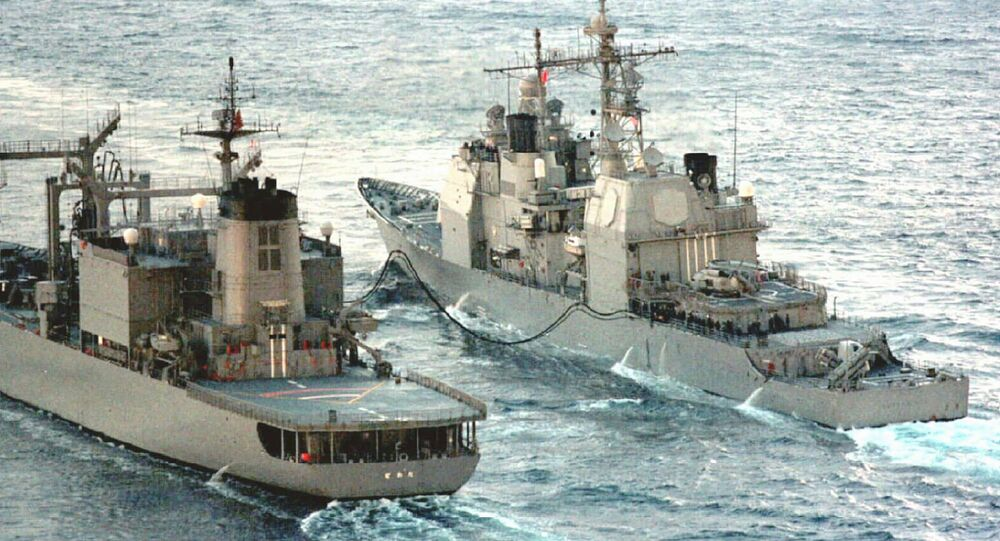 USS guided missile cruiser Bunker Hill being refueled