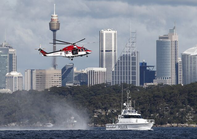 Police and emergency services train with an ambulance helicopter in Sydney Harbour in Sydney, Australia, Wednesday, July 27, 2016