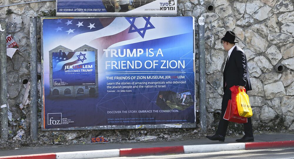 An Ultra-Orthodox Jewish man passes by a billboard welcoming President Donald Trump ahed of his visit, in Jerusalem, Friday, May 19, 2017