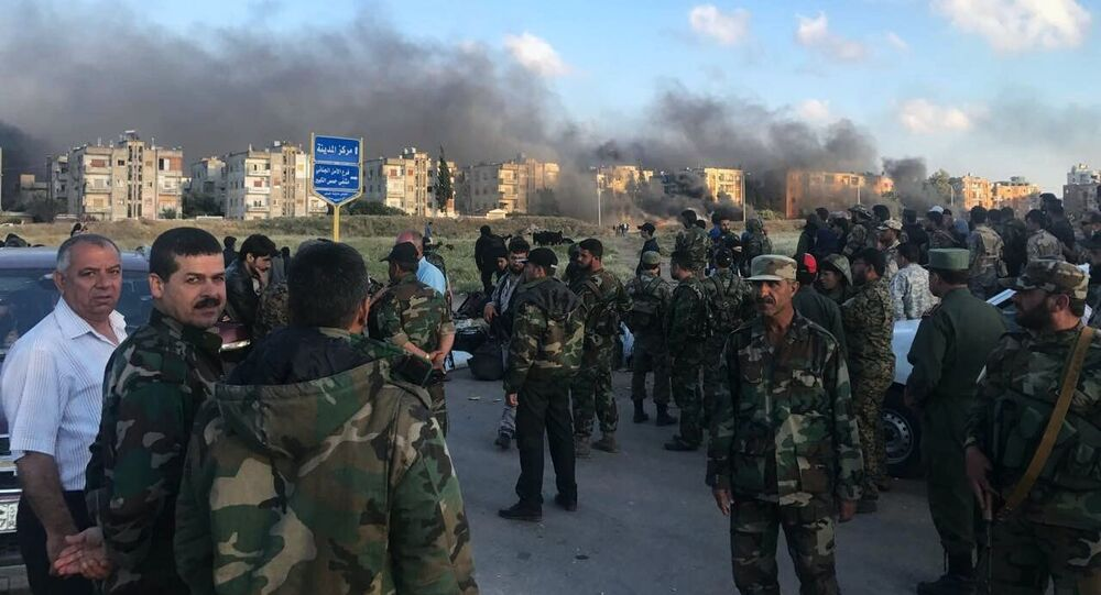 Sunday saw the complete withdrawal of militants from the western Syrian city of Homs