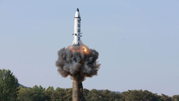 The scene of the intermediate-range ballistic missile Pukguksong-2's launch test in this undated photo released by North Korea's Korean Central News Agency (KCNA) May 22, 2017 - Sputnik International