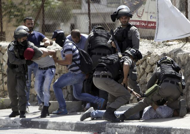 Israeli security forces arrest a Palestinians during clashes in Bethlehem, West Bank, Friday, May 19, 2017
