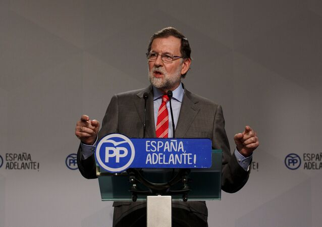Spain's Prime Minister Mariano Rajoy gestures during a news conference at his ruling People's Party's (PP) headquarters in Madrid, Spain May 22, 2017
