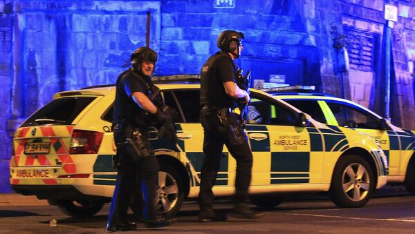 Armed police work at Manchester Arena after reports of an explosion at the venue during an Ariana Grande gig in Manchester, England Monday, May 22, 2017. - Sputnik International