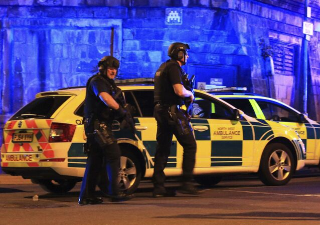 Armed police work at Manchester Arena after reports of an explosion at the venue during an Ariana Grande gig in Manchester, England Monday, May 22, 2017.