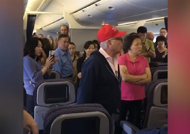 A belligerent man in a Trump hat was kicked off a flight