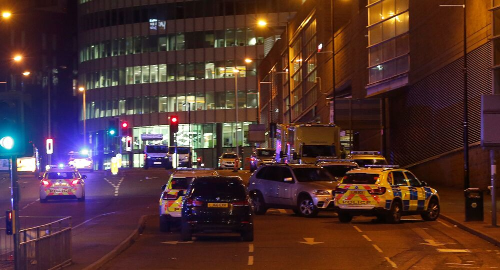 Vehicles are seen near a police cordon outside the Manchester Arena, where U.S. singer Ariana Grande had been performing, in Manchester, northern England, Britain, May 23, 2017.