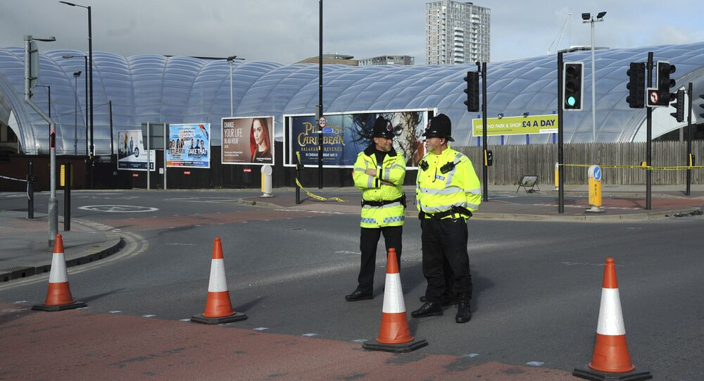 Police block a road outside the Manchester Arena in central Manchester, England Tuesday May 23, 2017.