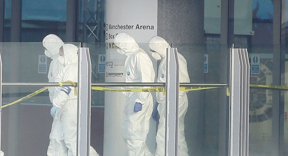 Forensics investigators work at the entrance of the Manchester Arena, Britain May 23, 2017.