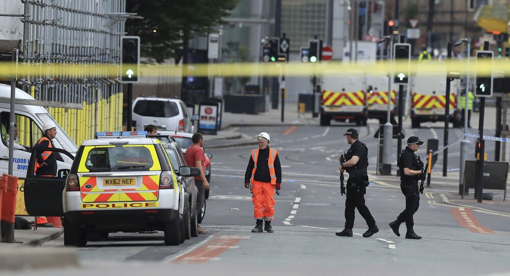 Police guard close to the Manchester Arena in Manchester, Britain a day after an explosion