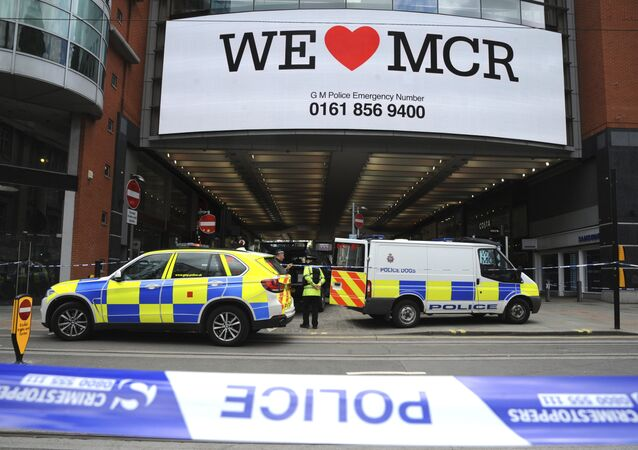 Police evacuate the Arndale shopping centre, in Manchester, England Tuesday May 23, 2017, the day after an apparent suicide bomber attacked an Ariana Grande concert as it ended Monday night, killing over a dozen of people among a panicked crowd of young concertgoers.