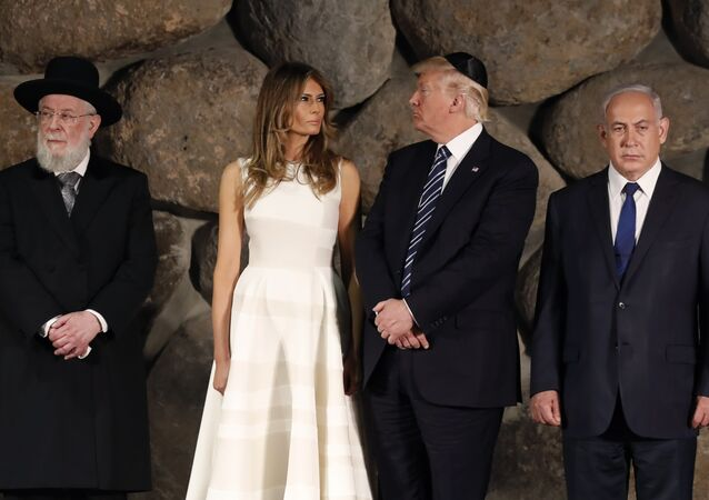US President Donald Trump, center, first lady Melania Trump, center left, , Rabbi Israel Meir Lau, left, Israeli Prime Minister Benjamin Netanyahu are seen during a visit to the Yad Vashem Holocaust Memorial museum