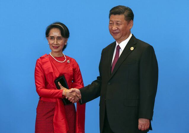 Chinese President Xi Jinping, right, shakes hands with Myanmar's State Counselor Aung San Suu Kyi as they attend the welcome ceremony at Yanqi Lake during the Belt and Road Forum, in Beijing, Monday, May 15, 2017.
