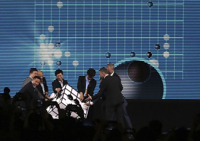 Go player Ke Jie of China, third from right, and other participants place pieces on a checkered cube during the opening ceremony of the Future of Go Summit in Wuzhen in eastern China's Zhejiang Province, Tuesday, May 23, 2017.