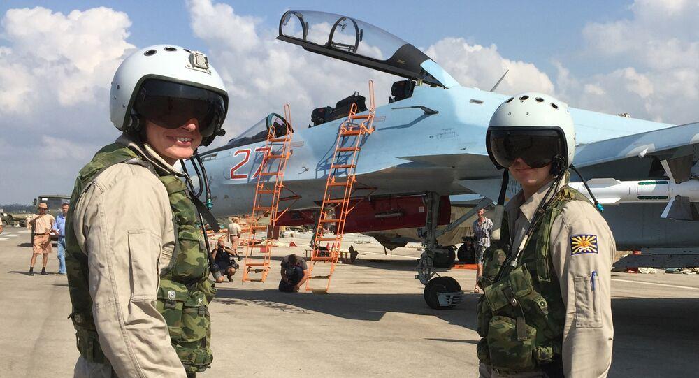 Russian pilots prepared to board the SU-30 attack plane to take off from the Hmeymim aerodrome in Syria.