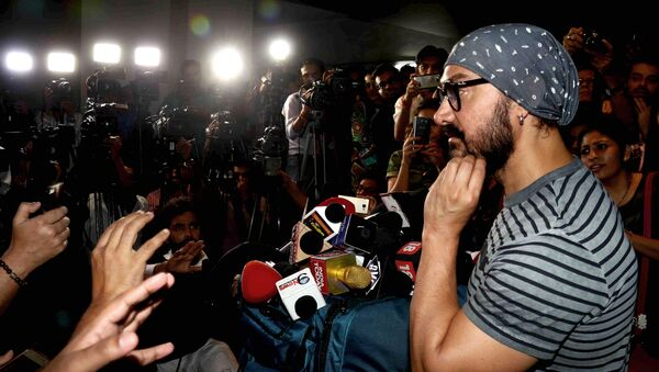 Indian Bollywood actor Aamir Khan interacts with the media during the promotion of the upcoming biographical sports drama Hindi film Dangal in Mumbai on November 28, 2016. - Sputnik International