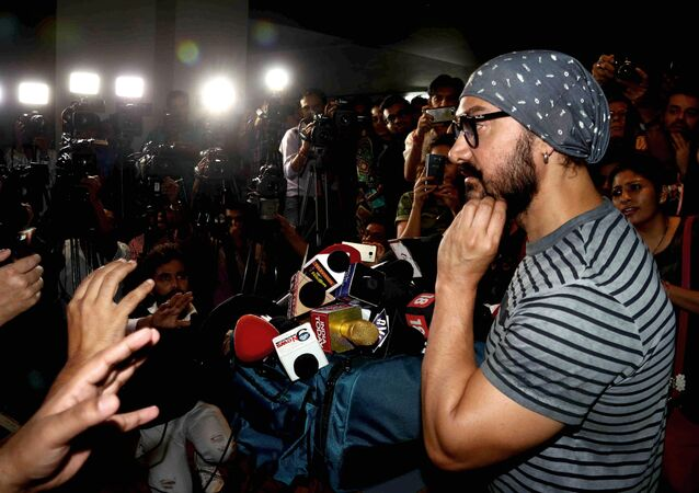 Indian Bollywood actor Aamir Khan interacts with the media during the promotion of the upcoming biographical sports drama Hindi film Dangal in Mumbai on November 28, 2016.