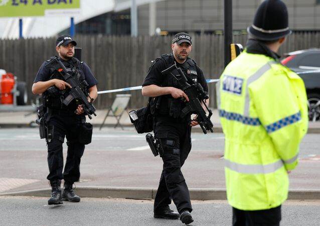 Armed police stand near the Manchester Arena in Manchester, Britain May 24, 2017.