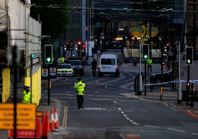 Police patrol the secure area outside the Manchester Arena in central Manchester, Britain May 23, 2017.