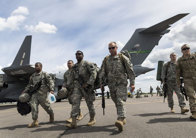 Members of the U.S. Army of the Pennsylvania National Guard arrival by plane at a airport in Vilnius, Lithuania, Sunday, June 5, 2016.