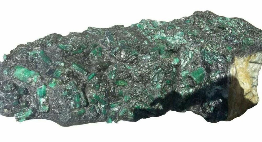This photo released by the Bahia Mineral Cooperative shows a 4.3-foot tall emerald weighing more than 600 pounds in Bahia, Brazil, Monday, May 22, 2017.