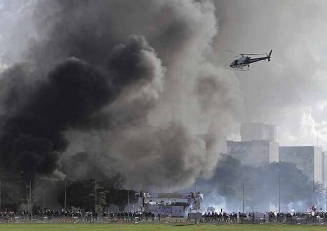Demonstrators clash with police during an anti-government protest in Brasilia, Brazil, Wednesday, May 24, 2017