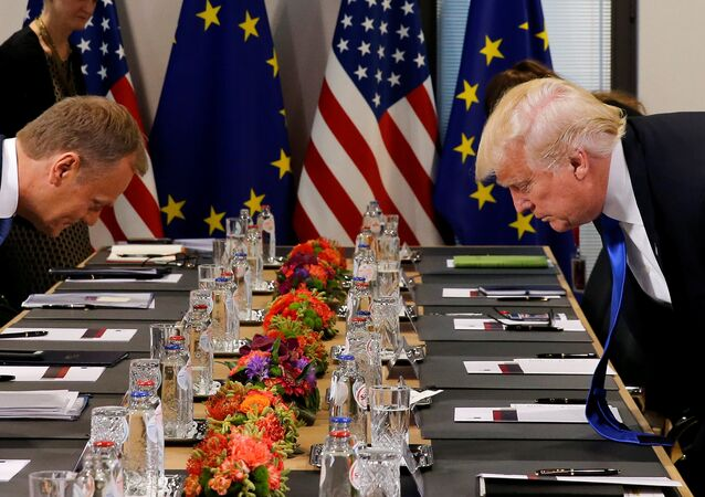 U.S. President Donald Trump (R) and the President of the European Council Donald Tusk take their seats before their meeting at the European Union headquarters in Brussels, Belgium, May 25, 2017.