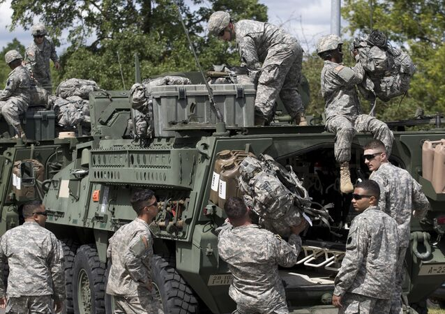 Members of the U.S. Army of the Pennsylvania National Guard unload equipment as they arrive at a airport in Vilnius, Lithuania, Sunday, June 5, 2016.