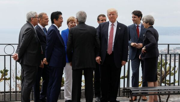 U.S. President Donald Trump gathers with (L-R) European Commission President Jean-Claude Juncker, European Council President Donald Tusk, Japanese Prime Minister Shinzo Abe, German Chancellor Angela Merkel, Italian Prime Minister Paolo Gentiloni, French President Emmanuel Macron, Canadian Prime Minister Justin Trudeau and Britain's Prime Minister Theresa May as they attend the G7 Summit in Taormina, Sicily, Italy, May 26, 2017. - Sputnik International
