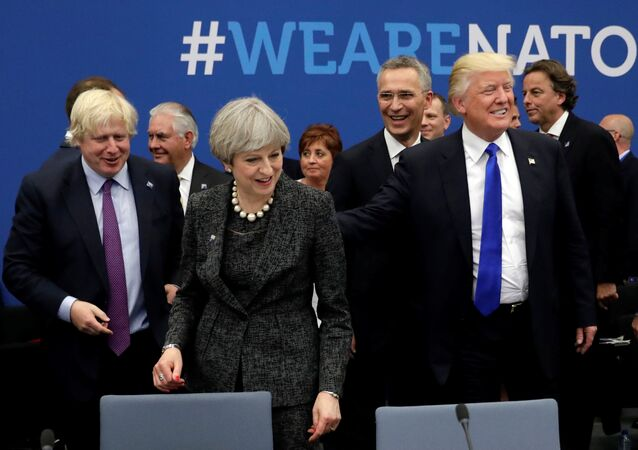Britain's Foreign Secretary Boris Johnson (L), U.S. President Donald Trump (R) and Britain's Prime Minister Theresa May (C) attend a working dinner meeting at the NATO headquarters during a NATO summit of heads of state and government in Brussels, Belgium, May 25, 2017.