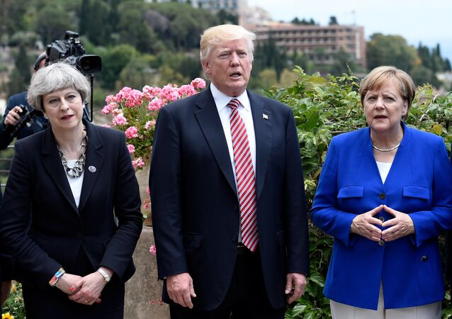 (L-R) Britain's Prime Minister Theresa May, U.S. President Donald Trump and German Chancellor Angela Merkel arrive to watch an Italian flying squadron as part of activities at the G7 Summit in Taormina, Sicily, Italy, May 26, 2017.