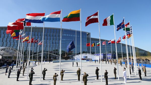 Flags of NATO member countires fly during a ceremony at the new NATO headquarters before the start of a summit in Brussels, Belgium, May 25, 2017 - Sputnik International