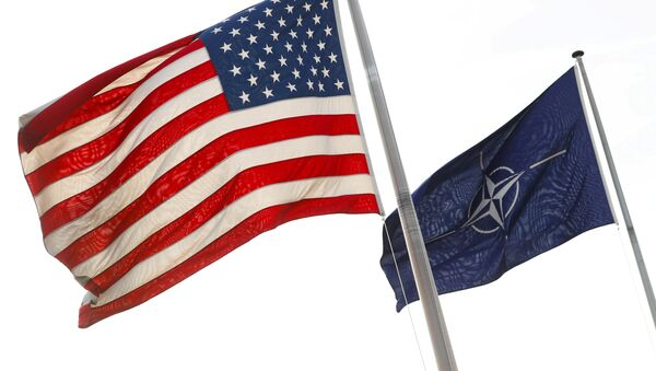 NATO and U.S. flags fly at the entrance of the Alliance's headquarters during a NATO foreign ministers meeting in Brussels, Belgium March 31, 2017 - Sputnik International