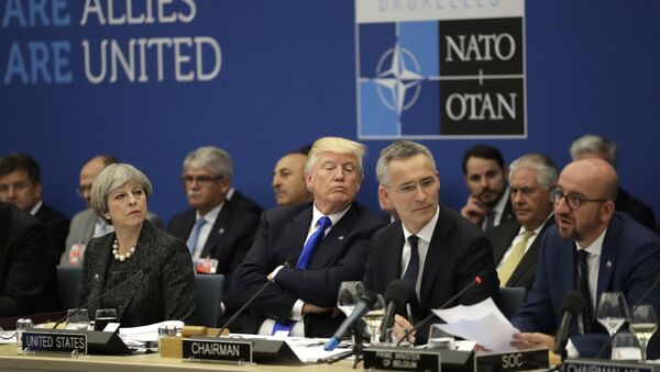 British Prime Minister Theresa May, U.S. President Donald Trump and NATO Secretary General Jens Stoltenberg listen to Belgian Prime Minister Charles Michel as he speaks during a working dinner meeting at the NATO headquarters during a NATO summit of heads of state and government in Brussels on Thursday, May 25, 2017 - Sputnik International
